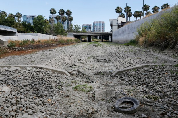 Looking south, one can see the dried up Guadalupe River near Santa Clara Street in San Jose, Calif., on Friday, July 17, 2015. (Jim Gensheimer/Bay Area News Group)