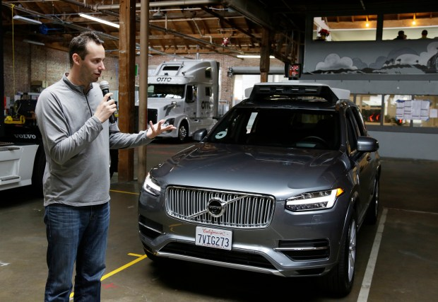 FILE- In this Dec. 13, 2016, file photo, Anthony Levandowski, head of Uber's self-driving program, speaks about their driverless car in San Francisco. Levandowski, an autonomous vehicle expert who defected from Google last year, notified Uber's staff of that he is stepping aside Thursday, April 27, 2017, in an email. He will remain at Uber, but won't oversee a crucial self-driving project targeted in lawsuit filed by Waymo, a rival started by Google. (AP Photo/Eric Risberg, File)