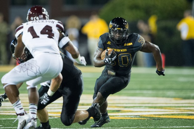 HATTIESBURG, MS - SEPTEMBER 5: Running back Jalen Richard #30 of the Southern Miss Golden Eagles looks to run the ball past linebacker Zach Jackson #14 of the Mississippi State Bulldogs on September 5, 2015 at M.M. Roberts Stadium in Hattiesburg, Mississippi. At halftime the Mississippi State Bulldogs leads the Southern Miss Golden Eagles 14-10. (Photo by Michael Chang/Getty Images)
