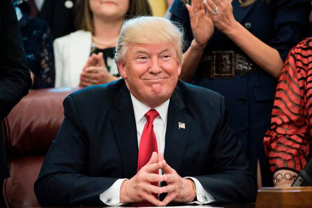 US President Donald Trump smiles during a national teacher of the year event in the Oval Office of the White House April 26, 2017 in Washington, DC. / AFP PHOTO / Brendan SmialowskiBRENDAN SMIALOWSKI/AFP/Getty Images