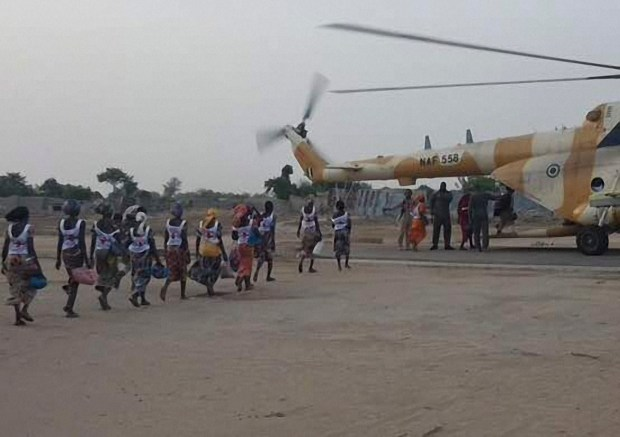 "This handout image provided by the International Committee of the Red Cross (ICRC) on May 7, 2017 at a military base in Borno State shows some of the 82 rescued Chibok girls heading towards a Nigerian Army helicopter. Eighty-two of the more than 200 schoolgirls kidnapped in northeast Nigeria in 2014 on Sunday headed to meet President Muhammadu Buhari after a prisoner swap deal with Boko Haram secured their release. / AFP PHOTO / RED CROSS / STR / RESTRICTED TO EDITORIAL USE - MANDATORY CREDIT ""AFP PHOTO / International Committee of the Red Cross- NO MARKETING NO ADVERTISING CAMPAIGNS - DISTRIBUTED AS A SERVICE TO CLIENTS  STR/AFP/Getty Images"