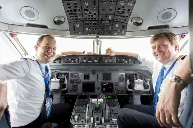 "This handout photo taken on May 16, 2017 and provided by the KLM Royal Dutch Airlines on May 17, 2017 shows Dutch King Willem-Alexander sitting inside the cockpit of a KLM Cityhopper, next to pilot Maarten Putman (L), at the Schiphol Airport, near Amsterdam. Dutch King Willem-Alexander, who works part-time as a commercial pilot, is to start conversion training to fly Boeing 737 passenger jets, a Dutch newspaper reported on May 17. The conversion training will mean the royal can continue to fly twice a month for KLM as a co-pilot. / AFP PHOTO / KLM / Natascha LIBBERT / - Netherlands OUT / RESTRICTED TO EDITORIAL USE - MANDATORY CREDIT ""AFP PHOTO / KLM"" - NO MARKETING NO ADVERTISING CAMPAIGNS - DISTRIBUTED AS A SERVICE TO CLIENTS == NO ARCHIVE NATASCHA LIBBERT/AFP/Getty Images"