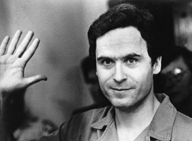 FILE - In this July 28, 1978, file pool photo, Ted Bundy mugs for the media after being informed of his indictment by a grand jury in Tallahassee, Fla. The Hollywood Reporter and Variety reported on May 16, 2017, that Zac Efron will play Bundy in an upcoming biopic about the serial killer. (Pool Photo via AP, File)