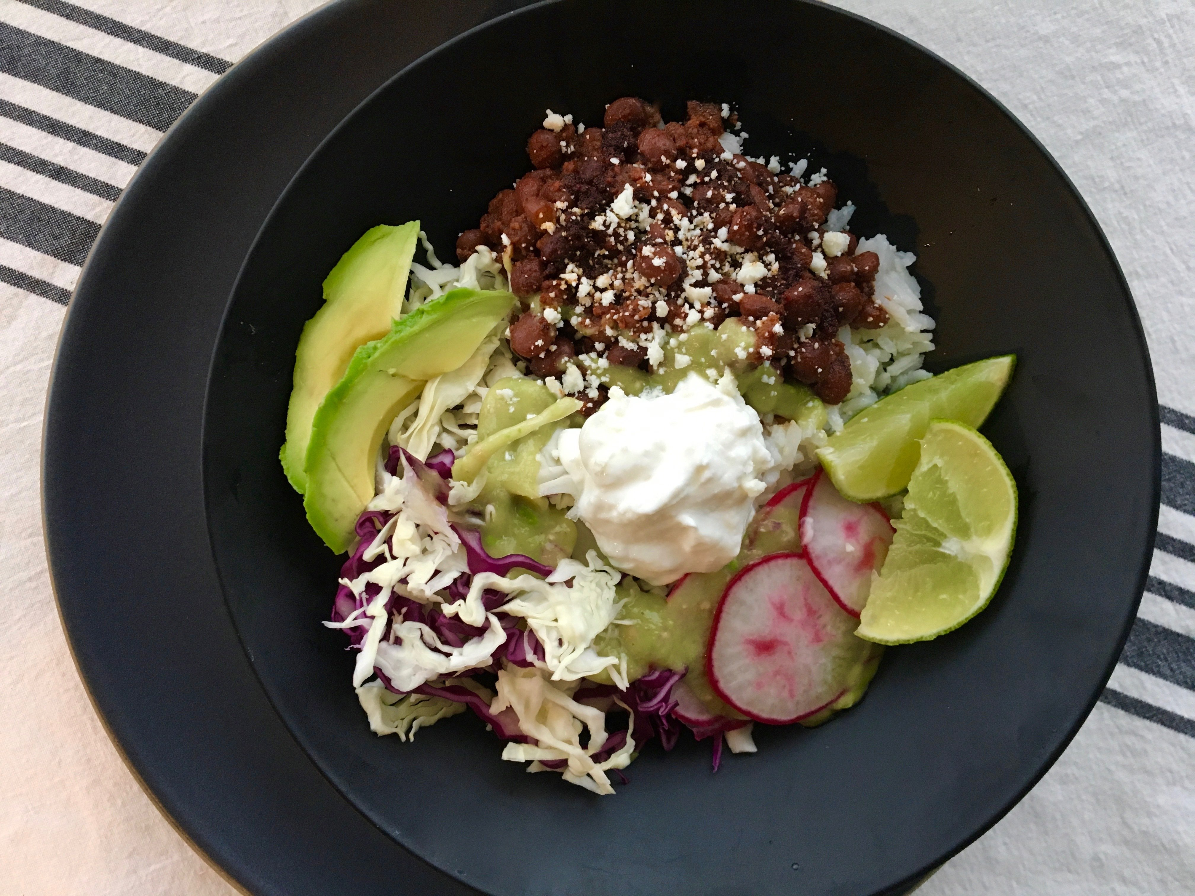 Rice bowls are one of the easiest and most delicious ways to tackle dinner. And this Mexican rice version with a chorizo-bean saute and avocado salsa is sensational. (A Little Yumminess)