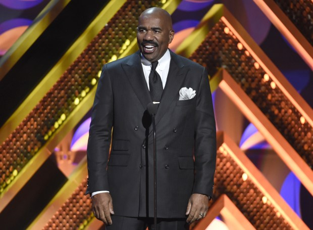 "FILE - In this April 26, 2015 file photo, Steve Harvey presents an award at the 42nd annual Daytime Emmy Awards in Burbank, Calif. The Fox network says it has picked up ""Showtime at the Apollo"" as a one-hour weekly series set to debut next season. Harvey will serve as host. (Photo by Chris Pizzello/Invision/AP, File)"