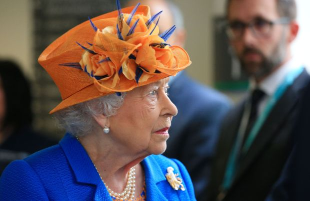MANCHESTER, ENGLAND - MAY 25: Queen Elizabeth II visits the Royal Manchester Children's Hospital to meet victims of the terror attack in the city earlier this week and to thank members of staff who treated them on May 25, 2017 in Manchester, England.  Queen Elizabeth visited the hospital to meet victims of the Manchester Arena terror attack and to thank members of staff who treated them. (Photo by Peter Byrne/WPA Pool/Getty Images)
