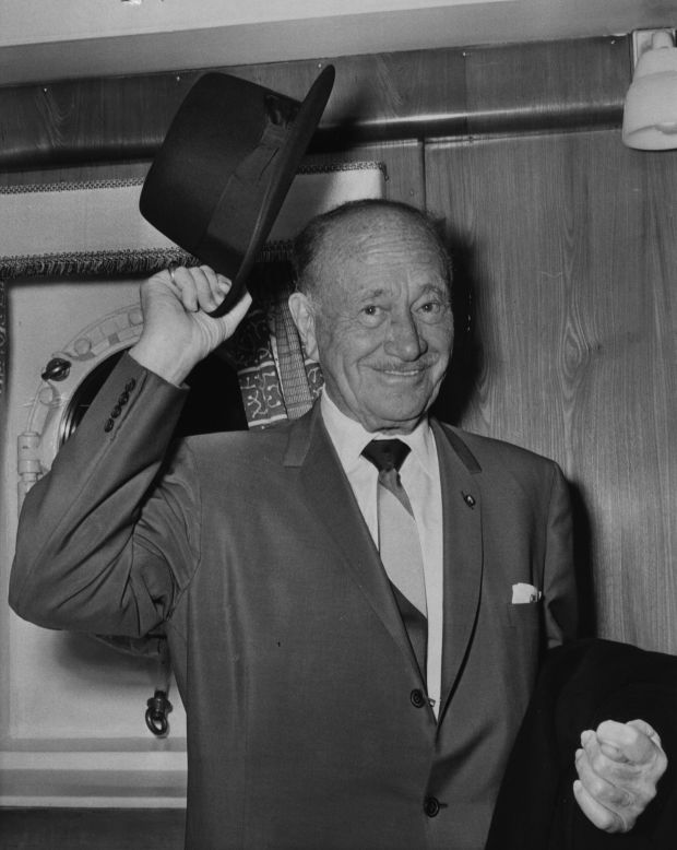 5th April 1964: Conrad Hilton (1887 - 1979) the Chairman and President of the eponymous hotel chain, tips his hat. (Photo by Hulton Archive/Getty Images)