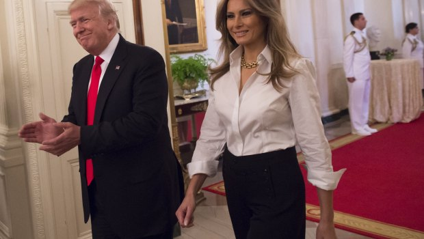 US President Donald Trump and First Lady Melania Trump arrive for a Mother's Day event for military spouses in the East Room of the White House in Washington, DC, May 12, 2017. / AFP PHOTO / SAUL LOEB (Photo credit should read SAUL LOEB/AFP/Getty Images)