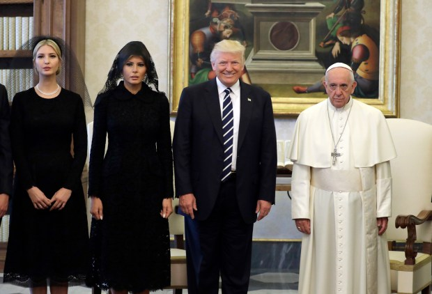 Pope Francis (R) poses with US President Donald Trump (C), US First Lady Melania Trump and the daughter of US President Donald Trump Ivanka Trump (L) at the end of a private audience at the Vatican on May 24, 2017. US President Donald Trump met Pope Francis at the Vatican today in a keenly-anticipated first face-to-face encounter between two world leaders who have clashed repeatedly on several issues. / AFP PHOTO / POOL / Evan Vucci (Photo credit should read EVAN VUCCI/AFP/Getty Images)