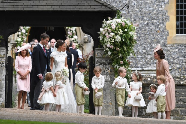ENGLEFIELD GREEN, ENGLAND - MAY 20: Pippa Middleton and her new husband James Matthews are seen with Catherine, Duchess of Cambridge and her children Prince George of Cambridge and Princess Charlotte of Cambridge leave church following their wedding ceremony at St Mark's Church as the bridesmaids and pageboys walk ahead on May 20, 2017 in Englefield Green, England. (Photo by Justin Tallis - WPA Pool/Getty Images)