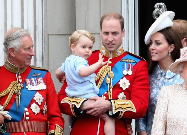 LONDON, ENGLAND - JUNE 13: Prince George of Cambridge is held by Prince William, Duke of Cambridge as Catherine, Duchess of Cambridg and Prince Charles, Prince of Wales watch on the Buckingham Palace balcony during the Trooping the Colour Ceremony on June 13, 2015 in London, England. . The ceremony is Queen Elizabeth II's annual birthday parade and dates back to the time of Charles II in the 17th Century when the Colours of a regiment were used as a rallying point in battle. (Photo by Chris Jackson/Getty Images)