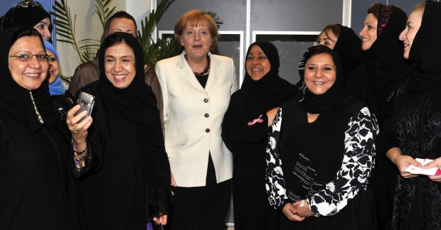 German Chancellor Angela Merkel poses for a photograph with Saudi Arabian business women in 2010. (AMER HILABI/AFP/Getty Images)