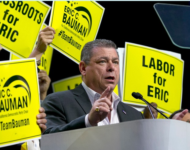 FILE - In this Saturday, May 20, 2017 file photo, Eric Bauman addresses the California Democratic Party annual convention as he seeks their vote for chairman in Sacramento, Calif. Bauman defeated Kimberly Ellis by a mere 62 votes out of nearly 3,000 cast, a razor-thin margin for a candidate who lined up support from most of the state's elected Democrats. As of midday Sunday, May 21, Ellis had not conceded the election. (AP Photo/Rich Pedroncelli, File)