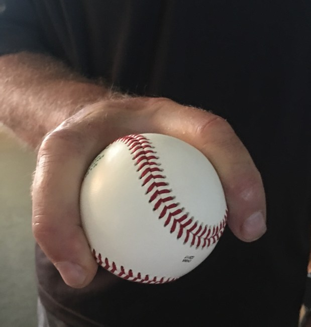 Former Giants pitcher Fred Breining, showing off his forkball grip, said he came up with the pitch after realizing his curveball had no chance against major league hitters. (Photo credit: Cathy Breining)