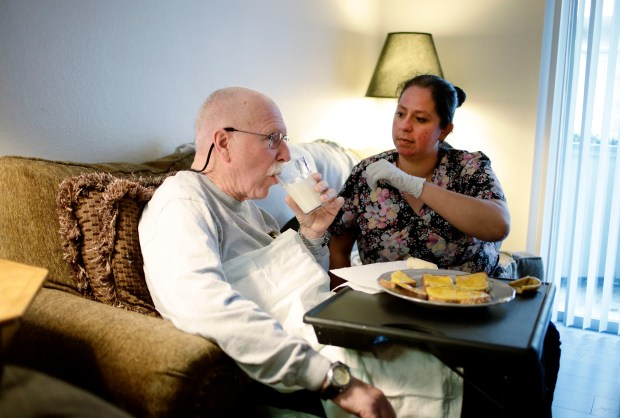 Steve Williams is helped with dinner by caregiver Erika Williams at his home in San Jose, Calif., on Thursday, May 25, 2017. Steve Williams was diagnosed with early onset Alzheimer's disease seven years ago. (Josie Lepe/Bay Area News Group)