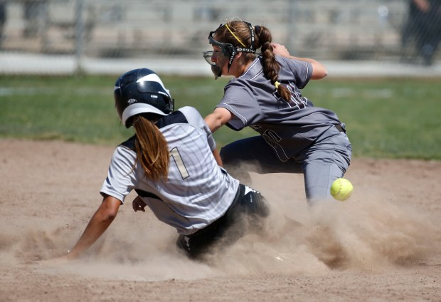 St. Francis' Alexandra Attard (10) loses the ball as Mitty's Lauren Lopez (1) slides safely into second in the fourth inning as Archbishop Mitty beat St. Francis 9-5 in the Central Coast Section Open Division softball championship at PAL Stadium in San Jose, Calif., Saturday, May 27, 2017. (Patrick Tehan/Bay Area News Group)