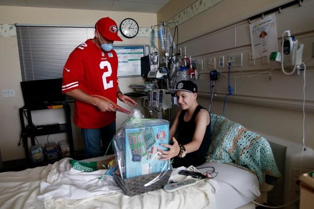 "San Francisco 49ers quarterback Brian Hoyer delivers ""Baskets of Hope"" to Moises Serna, 18, hospitalized at Kaiser Permanente Santa Clara Hospital's advanced care pediatrics unit on Monday, May 8, 2017, in Santa Clara, Calif. (Karl Mondon/Bay Area News Group)"