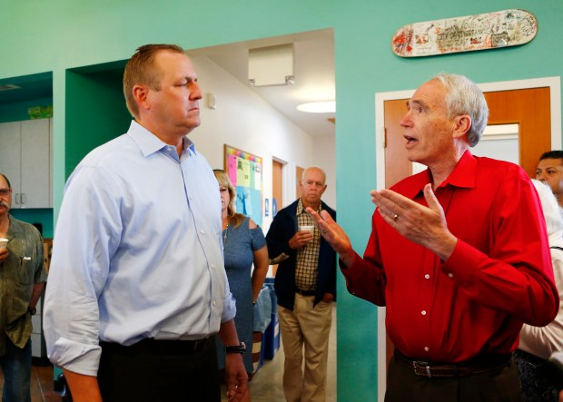 Rep. Jeff Denham, left, listens to Al Gelders, of Oakdale, vent his frustration during a meet-and-greet held in Riverbank, Calif., on Tuesday, May 9, 2017. Rep. Denham recently voted for the American Health Care Act after telling members of his district that he would vote against the bill. (Gary Reyes/ Bay Area News Group)