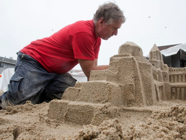 David Bockholt, of Foster City, works on his sand sculpture at the Pacifica Fog Fest in Pacifica, Calif., on Saturday, Sept 24, 2011. The festival kicked off Saturday morning with the Discover Pacifica Parade. Weekend events include a marching band competition, sand castle contest, arts and crafts booths, food and musical entertainment. The Fog Fest continues through Sunday. (John Green/Staff)