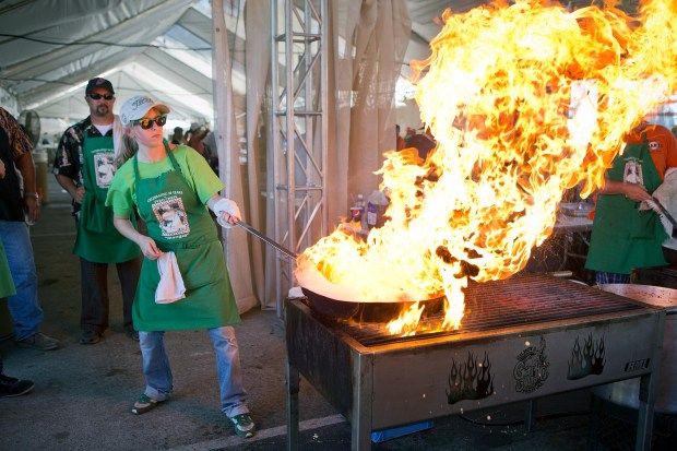 Pyro Chef Ashley Janisch cooks calamari at the Gilroy Garlic Festival, in Gilroy, Calif., on Friday, July 25, 2014. (LiPo Ching/Bay Area News Group)
