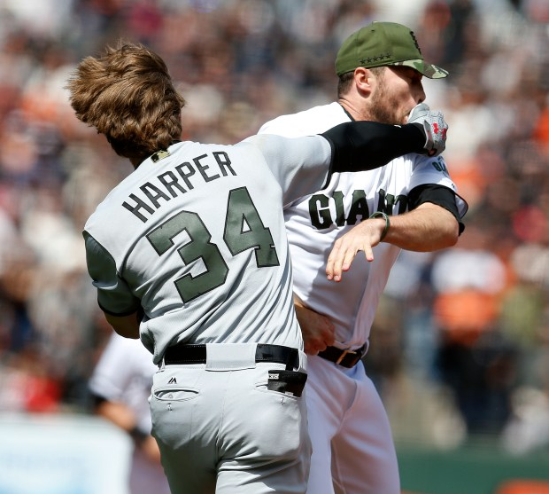 San Francisco Giants pitcher Hunter Strickland is punched by the Washington Nationals Bryce Harper (34) during the eighth inning of their game on Monday, May 29, 2017, in San Francisco, Calif. Harper was hit by a pitch from Strickland that started a fight between the two teams. (Aric Crabb/Bay Area News Group)