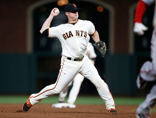 San Francisco Giants' Christian Arroyo (22) fields a ball hit by Washington Nationals' Trea Turner (7) in the fifth inning at AT&T Park in San Francisco, Calif., on Tuesday, May 30, 2017. Arroyo threw Washington Nationals' Matt Wieters (32) out at home plate. (Nhat V. Meyer/Bay Area News Group)