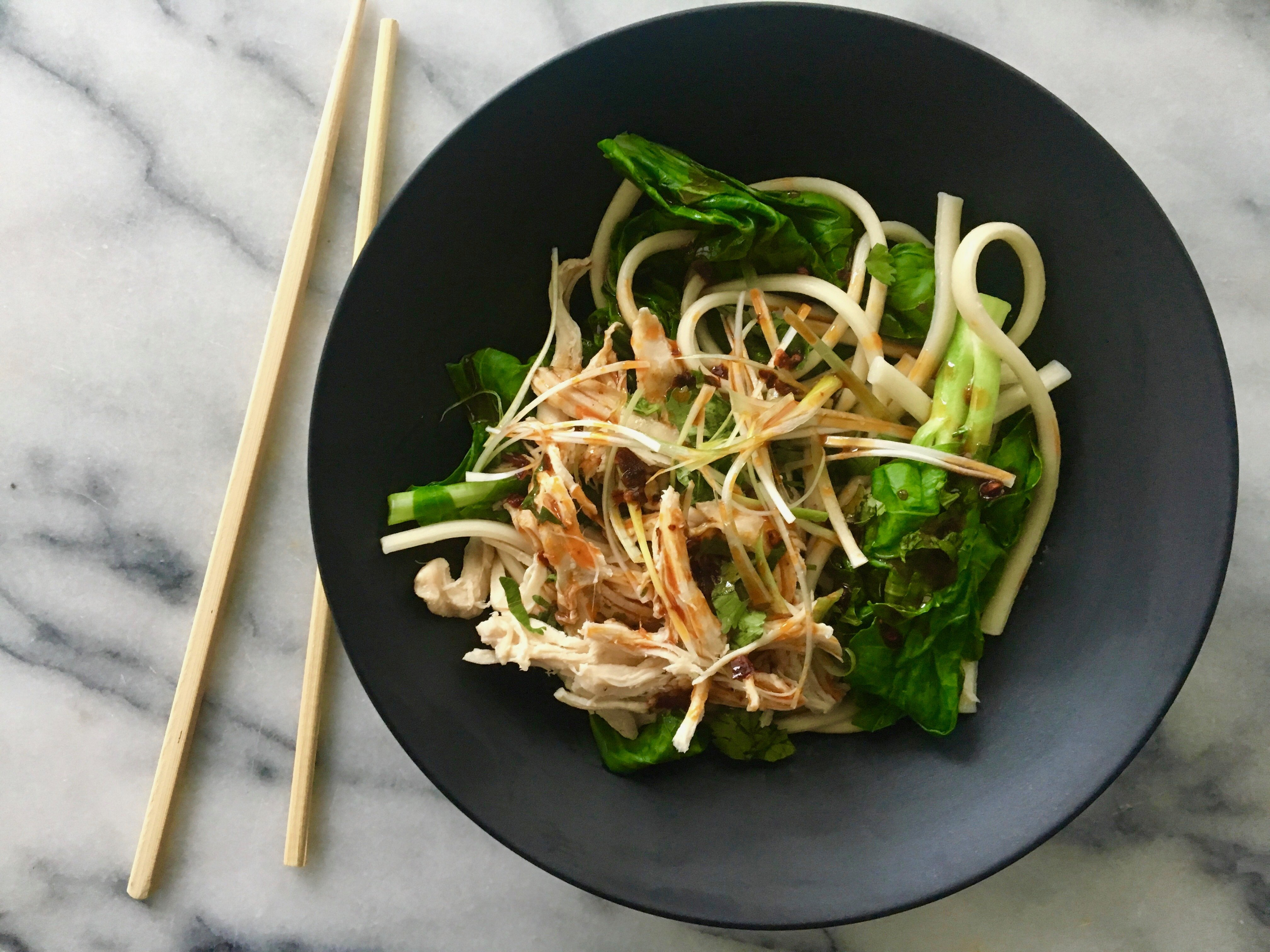 This easy dinner idea combines rotisserie chicken, fresh veggies and udon noodles. (Photo: A Little Yumminess)