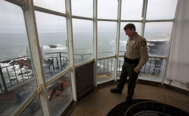 Terry Kiser, a state parks superintendent, looks over the rust and peeling pain in the lantern room in the Pigeon Point Lighthouse in Pescadero, Calif., Tuesday, May 30, 2017. The 1871-era Pigeon Point Lighthouse, the tallest lighthouse on the West Coast, continues to deteriorate and hasn't been repaired in the 12 years since it was transferred from federal to state ownership. (Patrick Tehan/Bay Area News Group)