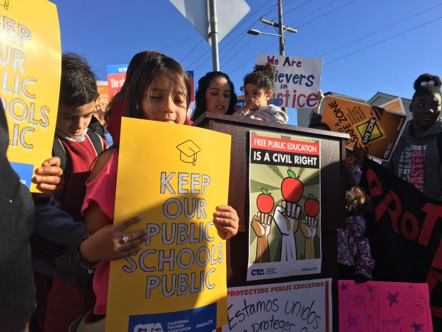 Students rally outside New Highland Academy in East Oakland, Calif., on May Day, May 1, 2017 to encourage keeping schools safe for immigrant students statewide. (Kristopher Skinner/Bay Area News Group)