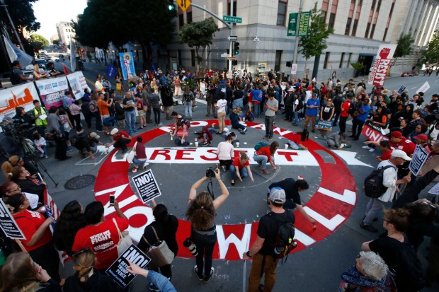 Protesters conduct a May Day rally in front of the Immigration and Customs Enforcement (ICE) office, Monday, May 1, 2017, in San Francisco, Calif. (Karl Mondon/Bay Area News Group)