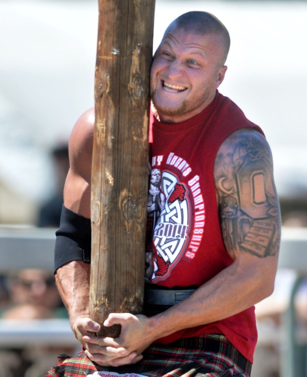 Adam Brezina, of Phoenix, Arizona, competes in the Men's Open Amateur Class caber toss during the 149th Scottish Highland Gathering and Games held at the Alameda County Fairgrounds in Pleasanton, Calif., on Saturday, Aug. 30, 2014. (Doug Duran/Bay Area News Group)