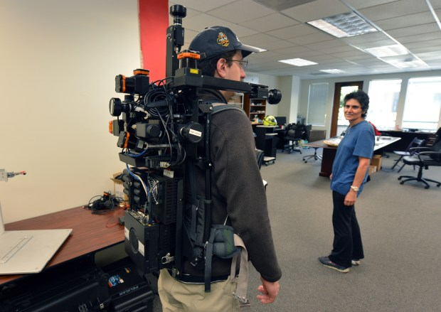 Plamen Levchev wears the backpack mapping unit created by Avideh Zakhor, a UC Berkeley electrical engineering/computer science professor and founder of Indoor Reality, at the company in Berkeley, Calif. on Monday, May 15, 2017. (Kristopher Skinner/Bay Area News Group)