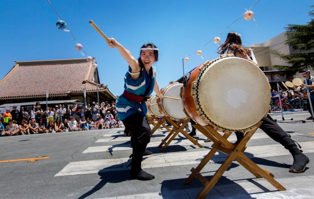 Members of Stanford Taiko perform during San Jose Buddhist Church Betsuin's annual Obon festival in San Jose, Calif., Saturday, July 9, 2016. (Patrick Tehan/Bay Area News Group)
