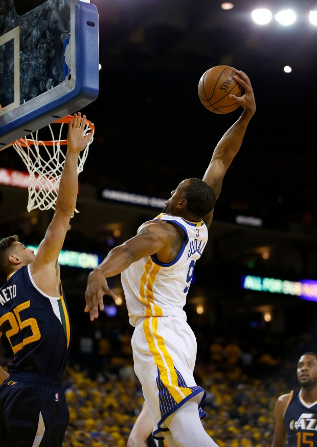Golden State Warriors' Andre Iguodala (9) dunks against against the Utah Jazz' Raul Neto (25) in the third quarter of Game 2 of their NBA second-round playoff series at Oracle Arena in Oakland, Calif., on Thursday, May 4, 2017. (Nhat V. Meyer/Bay Area News Group)