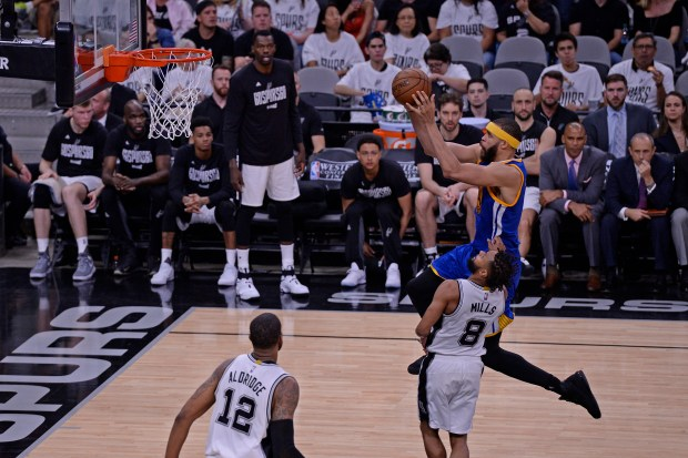 Golden State Warriors' JaVale McGee (1) goes up for a layup past San Antonio Spurs' Patty Mills (8) during the third quarter of Game 3 of the NBA Western Conference Finals at AT&T Center in San Antonio, Texas, on Saturday, May 20, 2017. The Golden State Warriors defeated the San Antonio Spurs 120-108. (Jose Carlos Fajardo/Bay Area News Group)