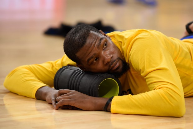 Golden State Warriors' Kevin Durant (35) lays on the court before the start of Game 4 of the NBA Western Conference Finals at AT&T Center in San Antonio, Texas, on Monday, May 22, 2017. (Jose Carlos Fajardo/Bay Area News Group)