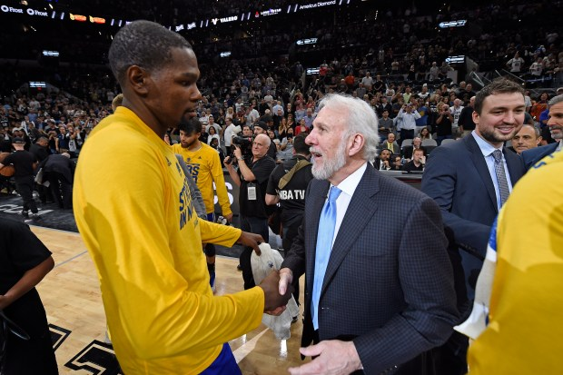 Golden State Warriors' Kevin Durant (35) is congratulated by San Antonio Spurs head coach Gregg Popovich after Game 4 of the NBA Western Conference Finals at AT&T Center in San Antonio, Texas, on Monday, May 22, 2017. Golden State Warriors defeat the San Antonio Spurs 129-115 to win the NBA Western Conference Final. (Jose Carlos Fajardo/Bay Area News Group)