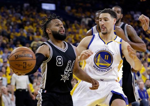 Klay Thompson's defense has taken away Patty Mills' effectiveness in the Western Conference Finals. (AP Photo/Marcio Jose Sanchez)