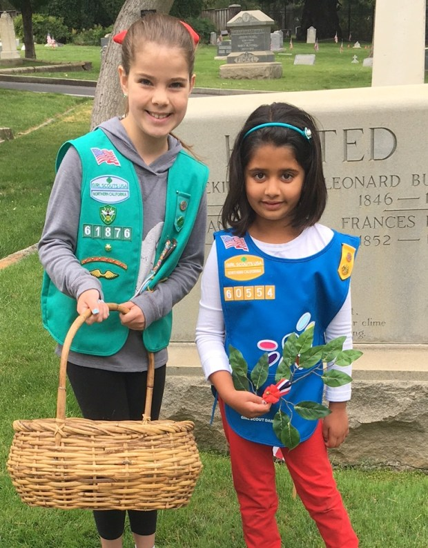 Juliet Steuer, 10, Girl Scout Troop 618 and Soha Khan, 6 at Madronia Cemetery on Memorial Day