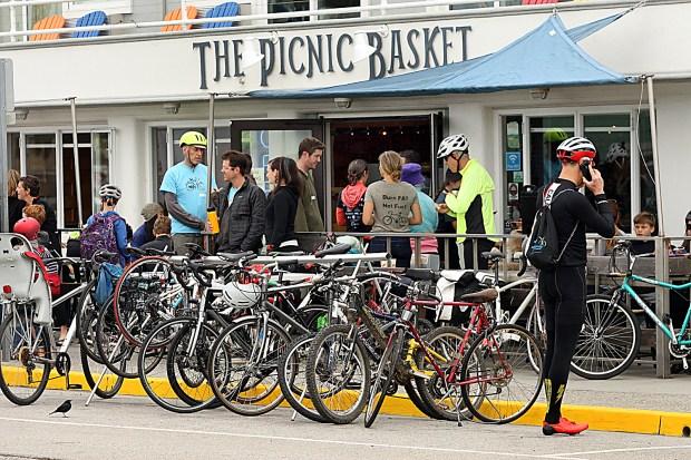 The Picnic Basket on Beach Street was a hub of two-wheeled activity for Bike To Work Day on Thursday. (Dan Coyro -- Santa Cruz Sentinel)