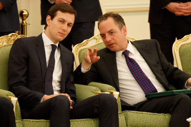 White House senior adviser Jared Kushner, left, talks with White House chief of staff Reince Priebus during a signing ceremony between President Donald Trump and Saudi King Salam, at the Royal Court Palace, Saturday, May 20, 2017, in Riyadh. (AP Photo/Evan Vucci)