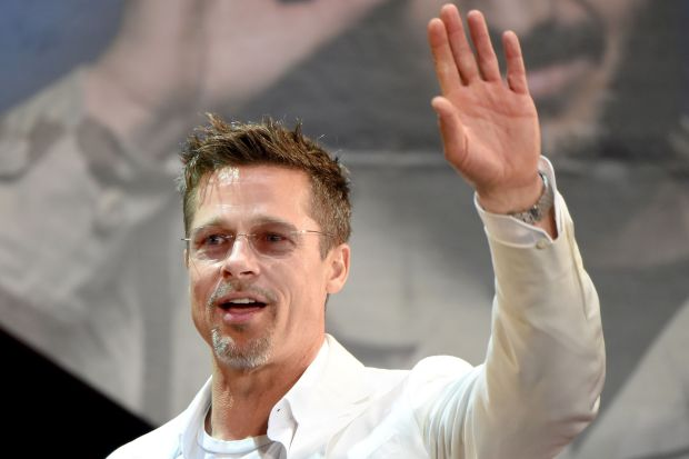 "US actor Brad Pitt waves to his fans during the Japan premiere of his latest movie ""War Machine"" in Tokyo on May 23, 2017.The film will be released by online streaming on May 26. / AFP PHOTO / Toru YAMANAKATORU YAMANAKA/AFP/Getty Images"