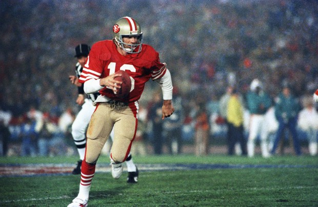 1984 San Francisco 49ers: Joe Montana, quarterback for the San Francisco 49ers, runs the ball during Super Bowl XIX against the Miami Dolphins on Jan. 21, 1985. (AP Photo)
