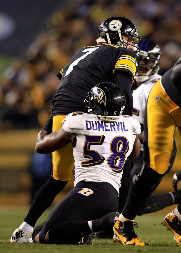 PITTSBURGH, PA - JANUARY 03: Elvis Dumervil #58 of the Baltimore Ravens sacks Ben Roethlisberger #7 of the Pittsburgh Steelers in the first quarter during their AFC Wild Card game at Heinz Field on January 3, 2015 in Pittsburgh, Pennsylvania. (Photo by Jamie Squire/Getty Images)