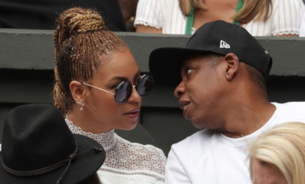 This file photo taken on July 9, 2016 shows US singer Beyonce (L) and her husband US rapper Jay Z (R) sitting in the players box to watch Serena Williams play against Germany's Angelique Kerber during the women's singles final of the 2016 Wimbledon Championships in Wimbledon, southwest London.Pop diva Beyonce and her rap mogul husband Jay-Z have welcomed twins, according to multiple US media reports, with two new members joining music's royal family that already includes five-year-old Blue Ivy. (Adam Davy/AFP/Getty Images