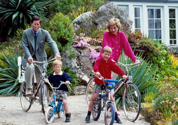 Britain's Prince Charles and Princess Diana and their sons, Princes William, right, and Harry begin a cycle ride, June 1, 1989, around the island of Tresco, one of the Scilly Isles. The royal family was vacationing in the islands, located off the southwest tip of Britain. (AP Photo)