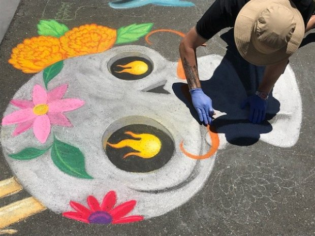 Roughly 20 artists descended on Pacific Commons in Fremont on Saturday forthe second annual Chalk Festival, and created all kinds of colorful imagery on one block of pavement in the shopping and social gathering area. (Photo courtesy of Heath McCue)