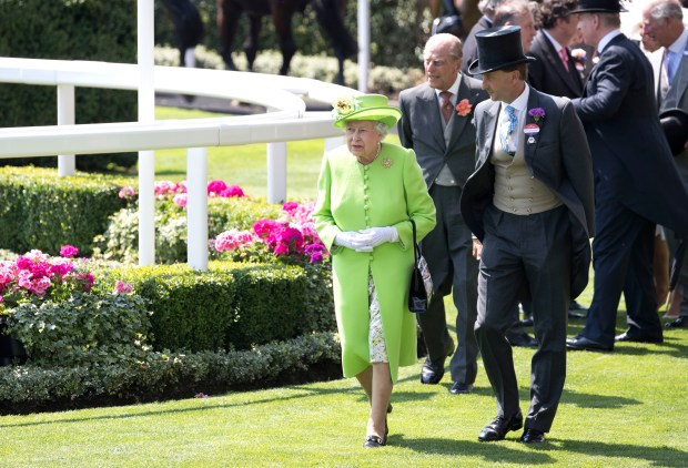Queen Elizabeth II, with Prince Philip, at Ascot Racecourse. (Photo by John Phillips/Getty Images for Ascot Racecourse)