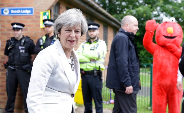 Britain's Prime Minister Theresa May leaves after voting in the general election in Maidenhead, England, Thursday, June 8, 2017. (AP Photo/Alastair Grant)