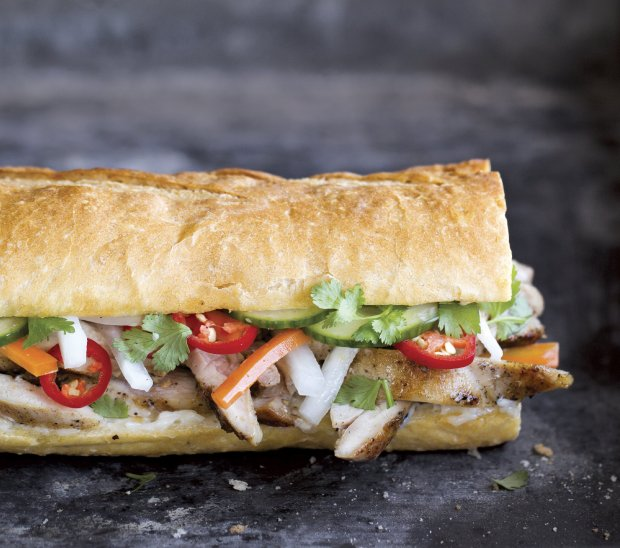 "This delicious sandwich recipe from Andrea Nguyen's ""Banh Mi Handbook""includes Hanoi grilled chicken, fresh herbs, pickled carrot and daikon and a cilantro-Maggi mayonnaise. (Must credit: Paige Green/Ten Speed Press-Penguin Random House)"
